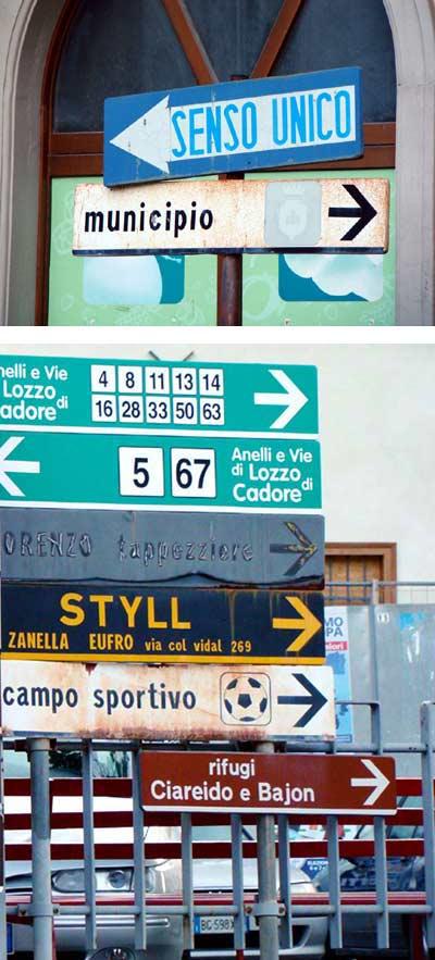 In alto: tabella arrugginita di fronte al municipio (a lato della cooperativa). Seguente: tabelle indecorose in piazza IV novembre